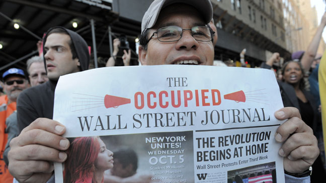 "A man holds up a copy of the ""Occupied Wall Street Journal"" newspapers as members of trade unions join Occupy Wall Street protesters as they march to Foley Square on October 5, 2011 in New York. The demonstrators are protesting bank bailouts, foreclosures and high unemployment from their encampment in the financial district of New York City. AFP PHOTO/Stan HONDA (Photo credit should read STAN HONDA/AFP/Getty Images)"